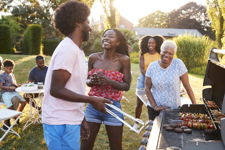 Couple laughing at a multi generation family barbecue