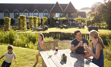 Family Enjoying Outdoor Summer Drink At Pub Stock Photo