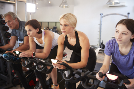 Group Taking Spin Class In Gym