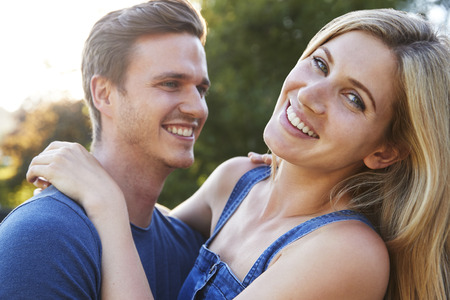 Portrait Of Smiling Couple Outdoors In Summer Park Stock Photo