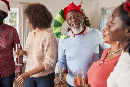 Parents With Adult Offspring Drinking Champagne As They Celebrate Christmas At Home Together