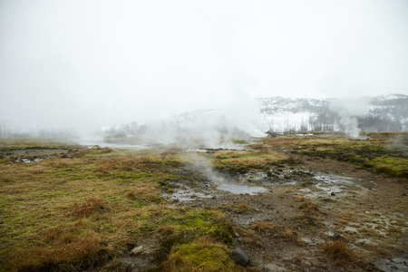 Steam Rising From Geothermal Pools In Icelandic Countryside