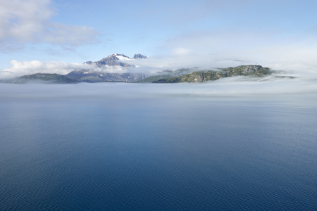 Lake And Mountains In Alaska Covered In Mist