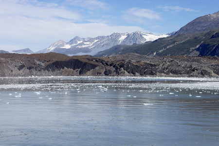 Ice Floating On Lake Surface With Mountains In Background In Alaska