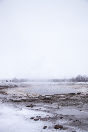 Tourists Visiting Steaming Geothermal Pools In Iceland