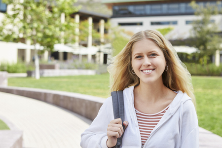 Portrait Of Female High School Student Outside College Buildings Stock Photo