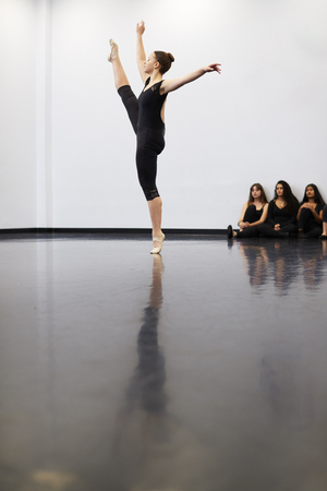 Female Ballet Student At Performing Arts School Performs For Class In Dance Studio Stock Photo
