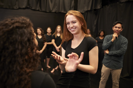 Teacher With Male And Female Drama Students At Performing Arts School In Studio Improvisation Class Reklamní fotografie