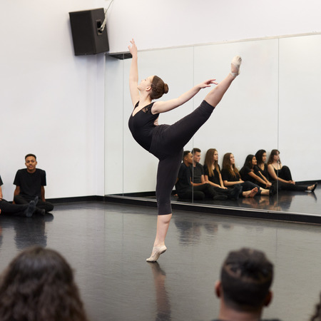 Female Ballet Student At Performing Arts School Performs For Class And Teacher In Dance Studio Stock Photo