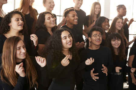 Male And Female Students Singing In Choir At Performing Arts School Stock Photo - 118540544