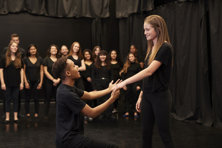 Male And Female Drama Students At Performing Arts School In Studio Improvisation Class