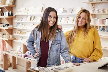 Portrait Of Two Female Customers In Independent Clothing And Gift Store Imagens