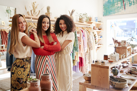 Portrait Of Three Female Sales Assistants Working In Clothing And Gift Store