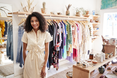 Portrait Of Female Owner Of Independent Clothing And Gift Store