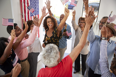 Three generation black family celebrating Independence Day together at home,elevated view