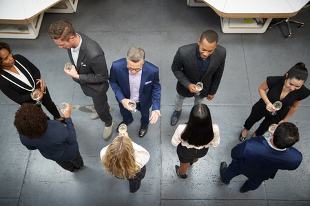 Overhead Shot Of Business Team Socializing At After Works Drinks In Modern Office
