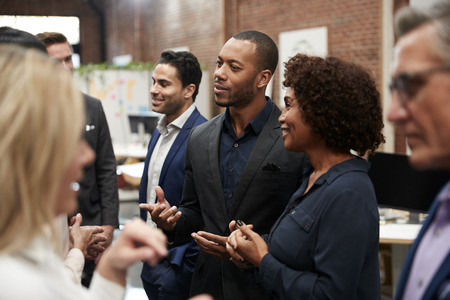 Business Team Standing Having Informal Meeting In Modern Office Reklamní fotografie