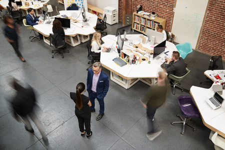 Overhead View Of Busy Modern Open Plan Office