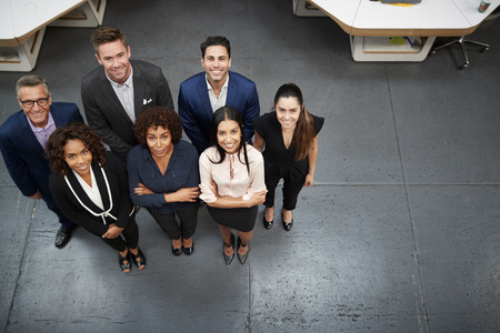 Overhead Portrait Of Business Team Standing In Modern Office