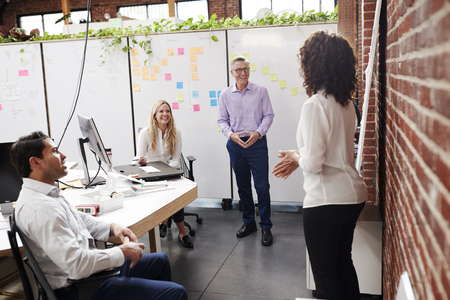 Creative Team Meeting To Discuss Ideas In Modern Office Stock Photo
