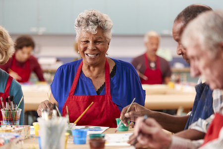Portrait Of Retired Senior Woman Attending Art Class In Community Centre 版權商用圖片