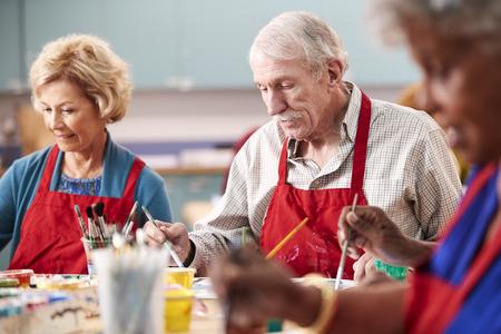 Retired Senior Man Attending Art Class In Community Centre Stock Photo
