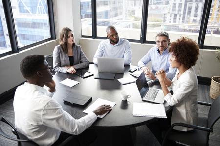 Elevated view of corporate business colleagues talking in a meeting room