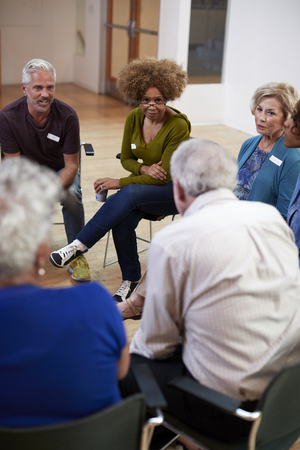 People Attending Self Help Therapy Group Meeting In Community Center Stock fotó