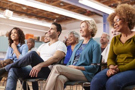 Group Attending Neighborhood Meeting In Community Center