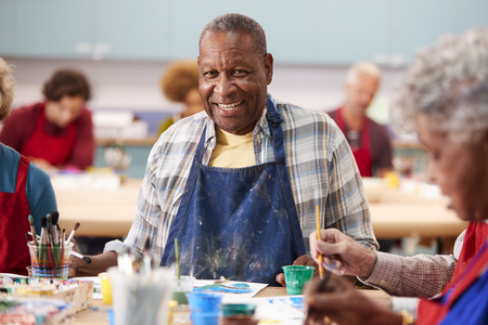 Portrait Of Retired Senior Man Attending Art Class In Community Centre