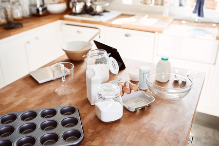 Ingredients And Baking Utensils Laid Out On Work Surface In Kitchen