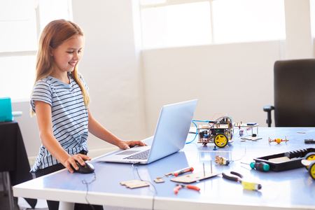 Female Student Building And Programing Robot Vehicle In After School Computer Coding Class Stock Photo