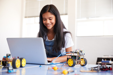 Female Student Building And Programing Robot Vehicle In After School Computer Coding Class 免版税图像