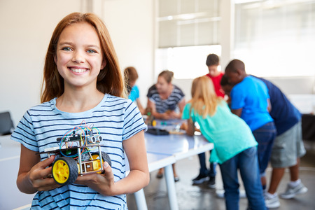 Portrait Of Female Student Building Robot Vehicle In After School Computer Coding Class Banque d'images