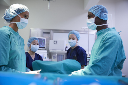 Surgical Team Working On Patient In Hospital Operating Theatre Stock fotó