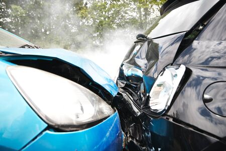 Close Up Of Two Cars Damaged In Road Traffic Accident Stockfoto