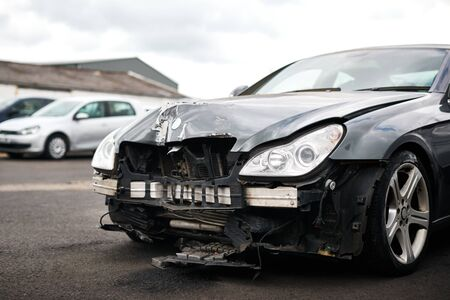 Detail Of Car Damaged In Motor Vehicle Accident Parked In Garage Repair Shop Stock Photo