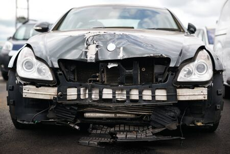 Detail Of Car Damaged In Motor Vehicle Accident Parked In Garage Repair Shop 스톡 콘텐츠