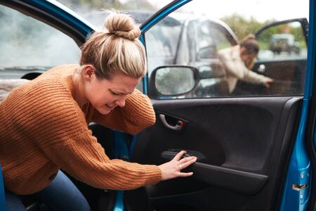 Female Motorist In Crash For Crash Insurance Fraud Getting Out Of Car 스톡 콘텐츠