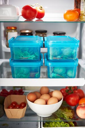 View Inside Refrigerator Of Healthy Food And Packed Lunches In Plastic Containers Stock Photo
