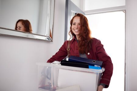 Female College Student Carrying Box Moving Into Accommodation Standard-Bild - 129668210