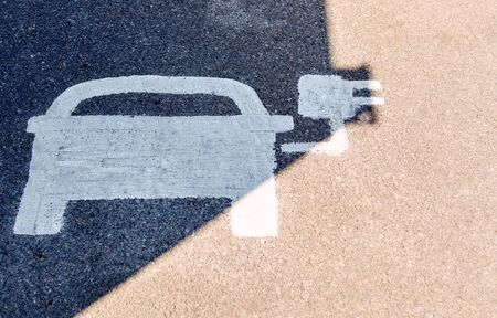 Painted Road Sign Indicating Electric Vehicle Recharging Parking Point