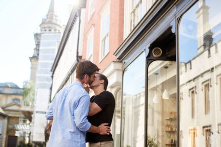 Loving Male Gay Couple Kissing Outside In City Street