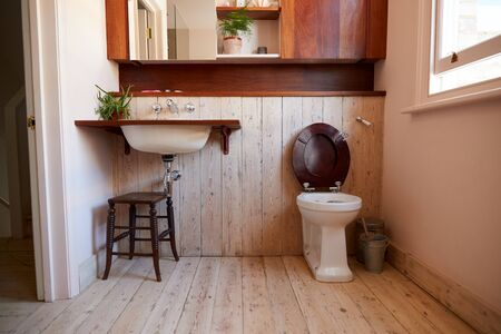 Empty Interior Of Contemporary Cloakroom With Sink And Toilet Stock Photo - 131145165