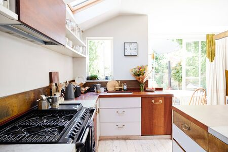 Empty Interior Of Contemporary Kitchen With Cooker And Storage