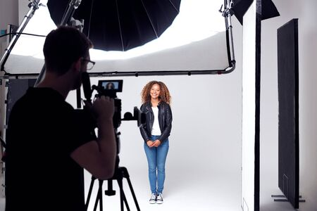Female Model Working On Set In Photographic Or Film Studio