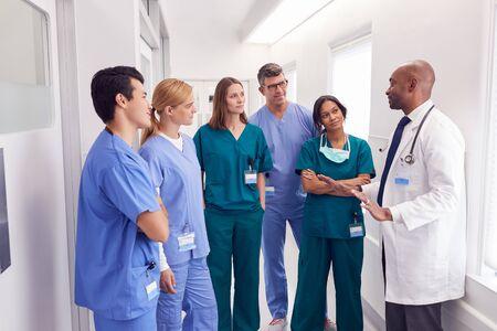 Multi-Cultural Medical Team Having Meeting In Hospital Corridor Reklamní fotografie
