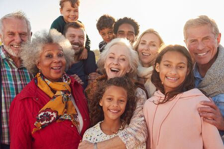 Portrait Of Multi-Generation Family Group On Winter Beach Vacation