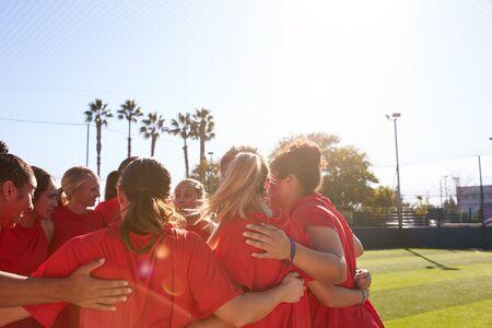 Womens Football Team In Huddle Having Motivational Pep Talk Before Soccer Match Reklamní fotografie