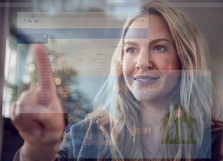 View From Behind Mobile Screen As Woman Transfers Money From Bank Account At Christmas